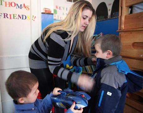 Lindsey Collins, shown with her sons Kevin, 5, and Julian, 2, in their Quincy home, lived in a series of motels